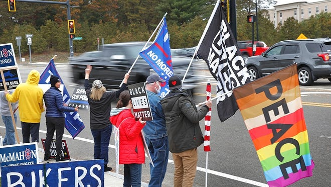 Political supporters stand out in West Plymouth to urge support for their candidates or cause on November 1, 2020 Greg Derr/ The Patriot Ledger