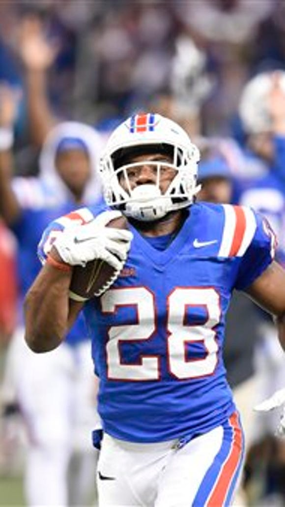 Louisiana Tech running back Kenneth Dixon (28) looks toward the video board while racing for a touchdown in the second half against Arkansas State in the New Orleans Bowl college football game in New Orleans, Saturday, Dec. 19, 2015. (AP Photo/Parker Waters)