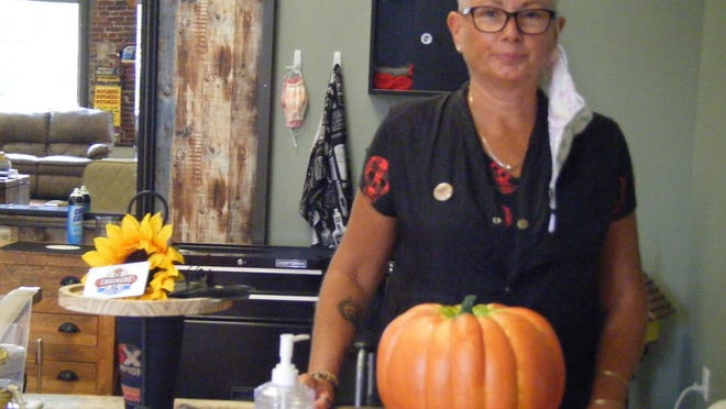 Pam Tibbetts, owner of Checkers Barber Shop, is planning a Halloween Block Party in front of the Leddy Building to celebrate her 10th year in that space.