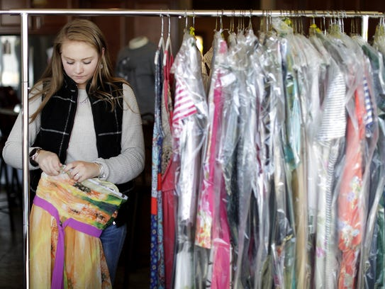 Appleton North High School senior Maddie Tesch prepares for the upcoming Hello Beautiful one-day resale dress shop. The event will be held Saturday at the Radisson Paper Valley Hotel in Appleton.