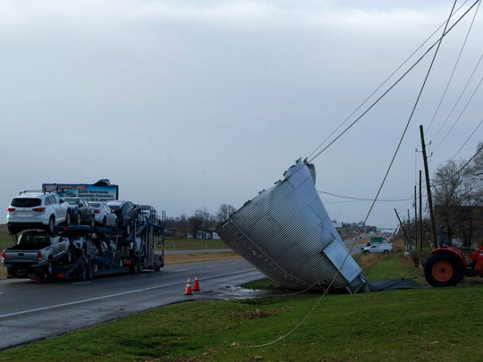 The silo of Ellen and Kelly Kramer Fort Branch, Ind., came to rest on the shoulder of Hwy 41 after last night's storms. A tractor is attached to the silo to keep it from possibly moving onto the highway. The silo was halted by telephone lines.