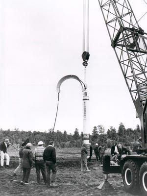 In this 1967 Photo a 29-kiloton hydrogen bomb is being readied over 4240-foot borehole for Project Gasbuggy.