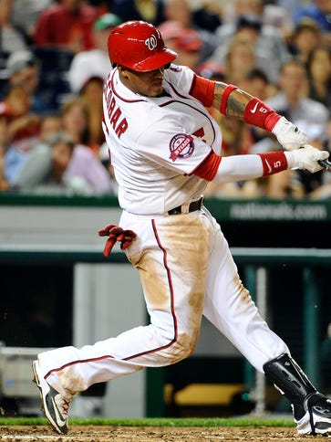 Yunel Escobar hits a single in the seventh inning at