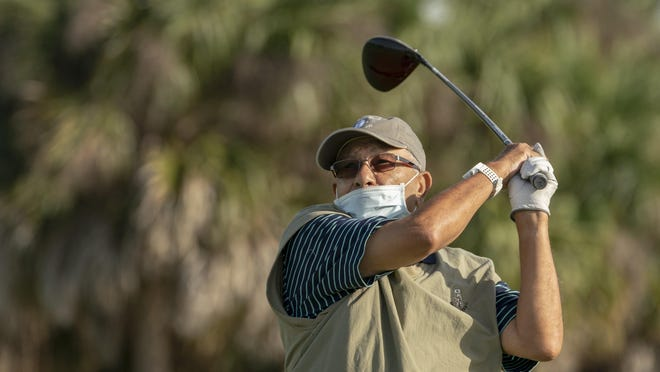 Kamal Griess tees off on the first hole of the Abacoa Golf Club in Jupiter on Wednesday. While golf courses and other recreational outlets reopened last week, restrictions remain in place for many Palm Beach County businesses.