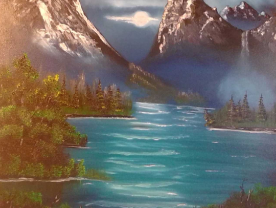 A haunting moon over mountains and water is the subject