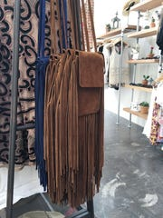 Add a little fringe to your festival style with an American Threads cell phone bag ($49).