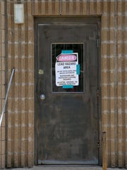 A hazard sign is seen during the renovations at Jackson Central-Merry Early College High, the former Jackson Central-Merry annex building, on Thursday, June 9, 2016.