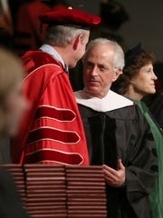 U.S. Senator Bob Corker, right, talks with Union University President Samuel 'Dub' Oliver as the processional continues to enter the sanctuary for the Union University fall commencement services at West Jackson Baptist Church in Jackson, Tenn., on Saturday, Dec. 17, 2016.