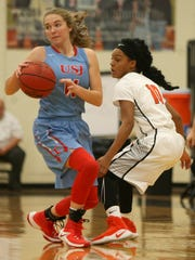 University School of Jackson's Kallie Pickens (11) comes up with a turnover versus Sequoya Warren (10) and Middleton during the Dyersburg Christmas Invitational in Terry Glover Gymnasium at Dyersburg High School in Dyersburg on Wednesday, Dec. 28, 2016.