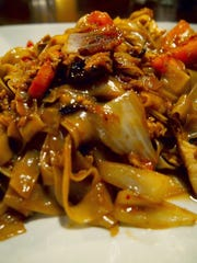 "Pad Kee Mao, which translates loosely as ""Drunken Noodles,"" is a popular Thai noodle dish."