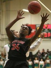 South Side's Tamia Curry (34) looks to grab the ball