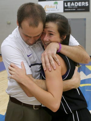 Trinity Christian Academy coach Matt Coble hugs Brynne Lytle (11) after their overtime victory against Mitchell during the Region 8-A semifinals at Jackson Christian in Jackson, Tenn., on Monday, Feb. 27, 2017.