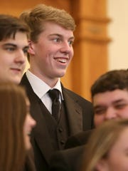 University School of Jackson Concert Choir member Tanner Atkins reacts to correctly answering a question from a judge during the Jackson Choral Festival at the R.E. Womack Memorial Chapel on the campus of the University of Memphis Lambuth in Jackson on Thursday, March 2, 2017.