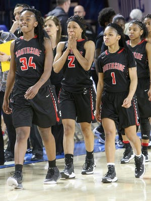 South Side's Tamia Curry (34), Makayla Transou (2) and Quanardra Miller (1) walk off the court after falling 52-43 to Upperman in the TSSAA Class AA state quarterfinals at the Murphy Center in Murfreesboro on Wednesday, March 8, 2017.