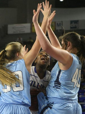 Huntingdon's Jesica Keith (44) tries to go up between Hampton's Brianna Hoyle (30) and Megan Garland (40) during the TSSAA Class A state quarterfinals at the Murphy Center in Murfreesboro, Tenn., on Thursday, March 9, 2017.