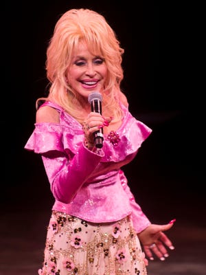 Dolly Parton speaks prior to the start of her new dinner show Smoky Mountain Adventures in Pigeon Forge on Friday, May 5, 2017.