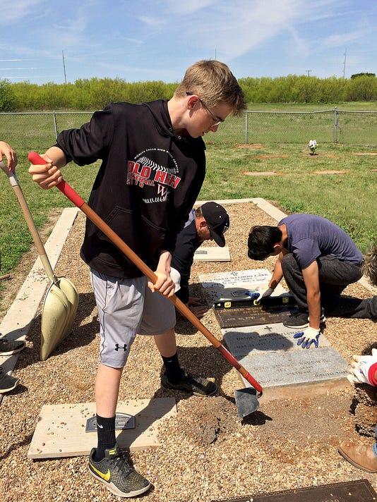 Boy Scouts, WFHS athletes clean up veterans' graves