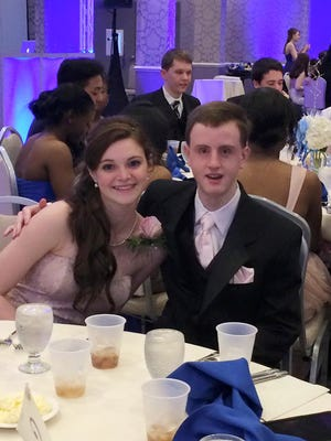 This March 28, 2015 photo provided by Kathty Lovetere shows Kaitlin McCarthy and Matty Marcone, students at Canton High School in Canton, Mass., at the schools junior prom. Kaitlin invited Matty, who has special needs, to be her date and they were crowned prom king and queen. Prom culture has changed so that some teens are now using the big night as a platform for social change and as an opportunity to be inclusive rather than exclusive.