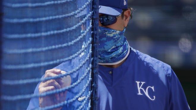 Kansas City Royals manager Mike Matheny watches baseball practice Thursday at Kauffman Stadium in Kansas City.