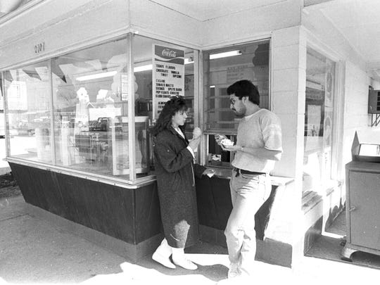 A couple enjoy their purchases at Tasty Twist, 1987.
