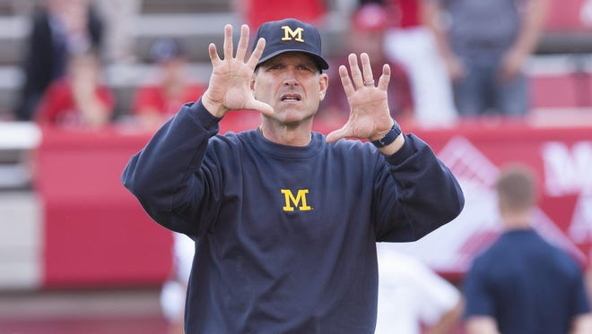 "Michigan football coach Jim Harbaugh has high praise for the latest Star Wars film ""The Force Awakens."""