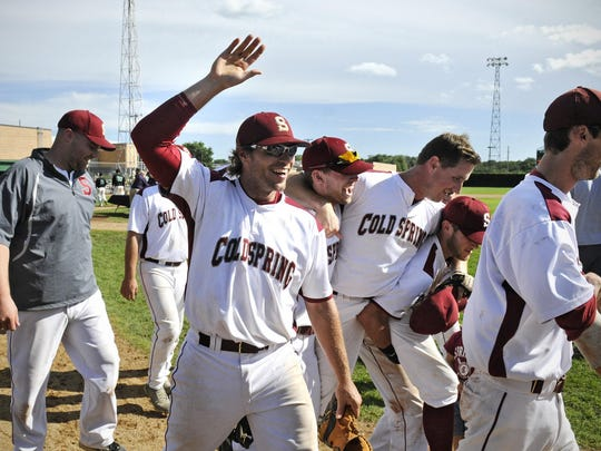 Cold Spring players react after winning the Minnesota Amateur Baseball Class B tournament championship game against BeaudreauÕs of St. Cloud on Monday, Sept. 1, 2014 in Belle Plaine.