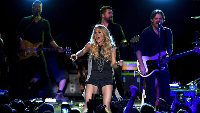 Carrie Underwood performs a surprise pop-up concert as part of CMT Instant Jam on Sept. 18, 2015, in Atlanta.
