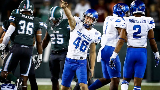 University of Memphis kicker Jake Elliott (middle) celebrates a Tigers' onside kick recovery against Tulane University during first-quarter action at Yulman Stadium in New Orleans.