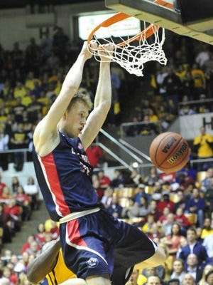 Belmont's Evan Bradds dunks against Murray State in the OVC men's tournament championship on March 7 at Municipal Auditorium in Nashville.