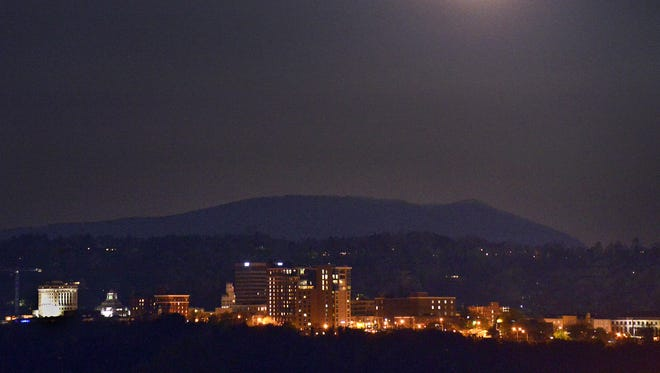 The April full moon, known as a pink moon, rises above downtown Asheville. It was also the firstl partial lunar eclipse of 2013 although the eclipse happened while the moon was still below the horizon in most of North America. The other lunar eclipses this year will occur on May 25 and Oct. 18. Only the October eclipse will be visible in WNC.