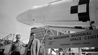 Ald. Mark W. Ryan (left) and Wisconsin Regional Space Center Director Robert Thompson check out an Agena rocket at the opening of the Wisconsin Regional Space Center, 835 N. 7th St., on July 7, 1968.