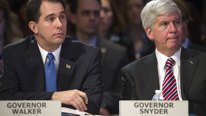 Wisconsin Gov. Scott Walker, left, and Michigan Gov. Rick Snyder participate in the morning session of  the National Governor's Association winter meeting in Washington on Feb. 22.