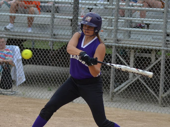 Johnston's Sara Knee, 15, keeps her eye on the ball at bat at the Johnston vs Valley baseball and softball games held at Valley High School on June 16, 2014.