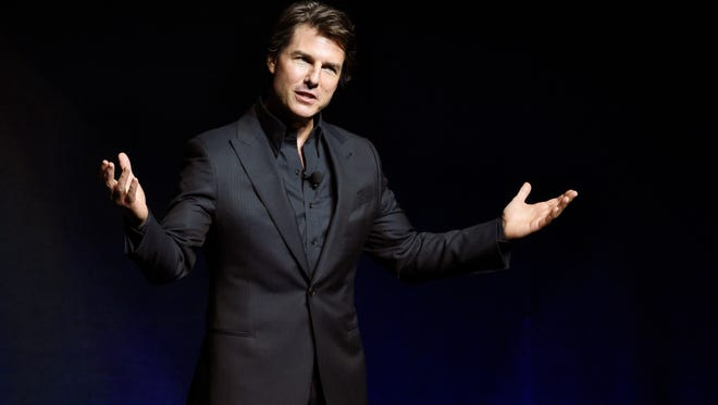 """Tom Cruise, star of the upcoming film """"Mission: Impossible: Rogue Nation,"""" addresses the audience during a surprise appearance at the Paramount Pictures presentation at CinemaCon 2015 at Caesars Palace on Tuesday, April 21, 2015, in Las Vegas."""