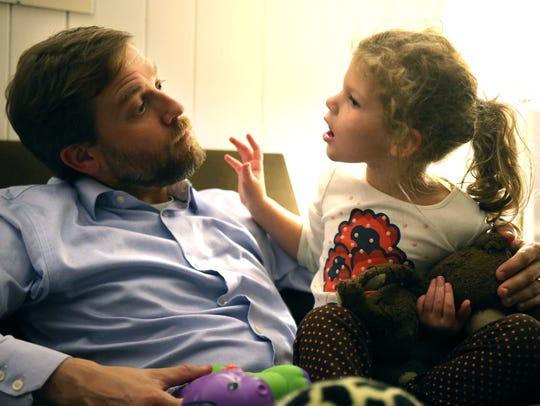 Frazer Gieselmann works on vocalization with daughter Elle, who has Batten disease.