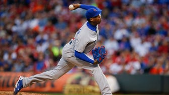 Cubs relief pitcher Aroldis Chapman delivers to the plate in the eighth inning.
