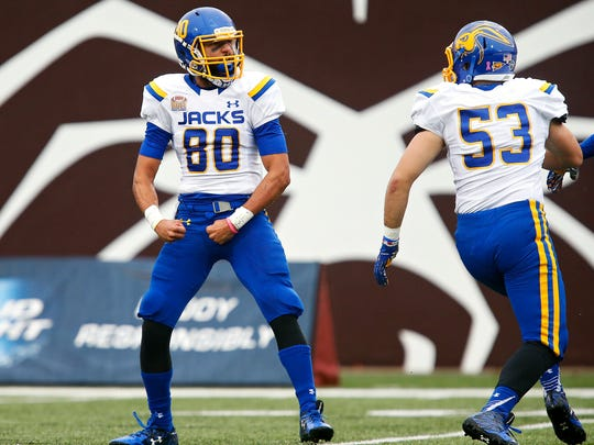 South Dakota State Jackrabbits wide receiver Trevor Wesley (80) flexes after a big hit during second quarter action of the Missouri State Bears game against the South Dakota State jackrabbits at Robert W. Plaster Stadium in Springfield, Mo. on Oct. 31, 2015.