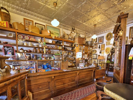 Antiques (and pop) are for sale in the Virgelle Merc.