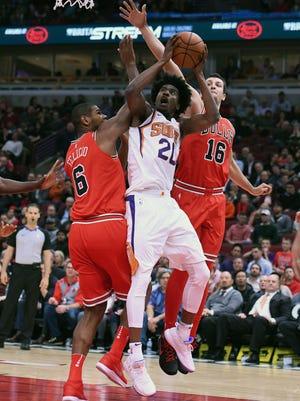 Phoenix Suns forward Josh Jackson (20) shoots the ball against Chicago Bulls center Cristiano Felicio (6) during the first half at the United Center.