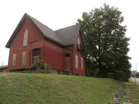 An 1868 gothic revival house at the corner of Walnut