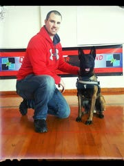 Calumet County Sheriff's Department Deputy Will Pearson poses with K9 Amer, the department's first K9 unit.