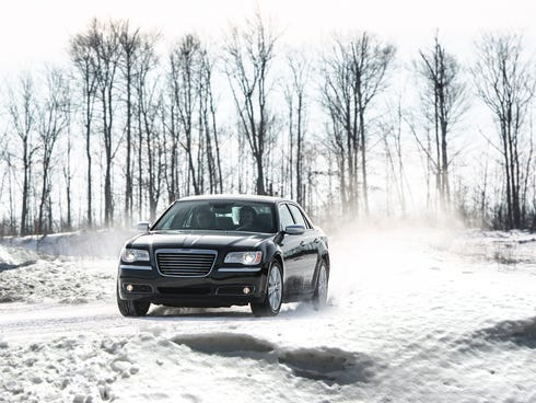 The 2014 Chrysler 300 sedan is available with rear-drive or a sophisticated all-wheel drive system for foul-weather climates.