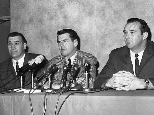 FILE - In this January 1966 file photo, George Allen, defensive coach of the Chicago Bears who was hired as head coach of the Los Angeles Rams, is flanked by two Bear defensive stars, Joe Fortunato, left, and Doug Atkins, at a Los Angeles news conference announcing his new job in Los Angeles. Fortunate and Atkins, staying at the hotel where the conference took place, dropped in to voice approval of Allen's ability. Fortunato, the speedy linebacker who helped the Bears win the 1963 NFL title, has died. He was 87. Fortunato died Monday, Nov. 6, 2017, in Mississippi, where he starred at linebacker and fullback at Mississippi State. (AP Photo/File)
