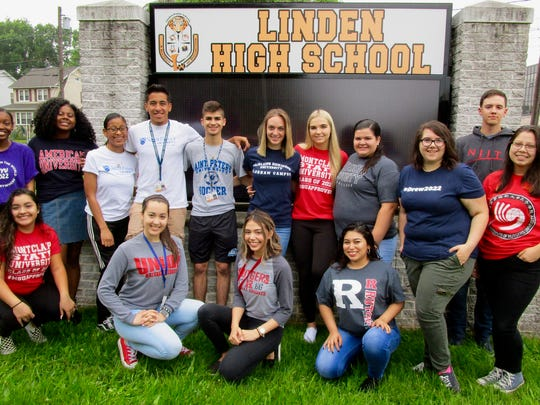 Linden High School seniors wore shirts for their selected college during the school's College Day on Thursday, May 31. LHS alumni and other visitors came in for assemblies to talk to the students about college life.  Standing from left: Nyssa Joseph (New York University, majoring in economics and sociology, scholarship from LHS Alumni Association); Miesha Burnam (American University, international studies, scholarship from the Violette Thompson Scholarship Fund); Perla Cabrera (St. Peters University; clinical psychology); Juan Montes (St. Peter's College, criminal justice, soccer scholarship, former ESL student and International Baccalaureate Diploma candidate); Brian Carvalhoso (St. Peters College, computer science); Toni Frino (Fairleigh Dickinson University, nursing, NJSIAA scholar athlete scholarship and UNICO scholarship); Claudia Rusin (Montclair State University, nutrition and food science); Arianna Agusti (Union County College, business); Christina Beviano (Drew University, international relations, Dean's Scholarship); Marko Hernandez (New Jersey Institute of Technology, mechanical engineering, Air Force ROTC); Daniela Sanchez (Rider University, environmental science). Front row: Jesenia Terrones (Montclair State University, psychology); Karina Amaral (Union County College, accounting, NJ STARS scholarship); Emily Estrada (Rutgers University-New Brunswick, psychology/cognitive science, IB Diploma candidate); Jennyfer Mendoza (Rutgers University School of Engineering, electrical engineering, NJROTC Scholarship, American Red Cross High School Scholarship Program).