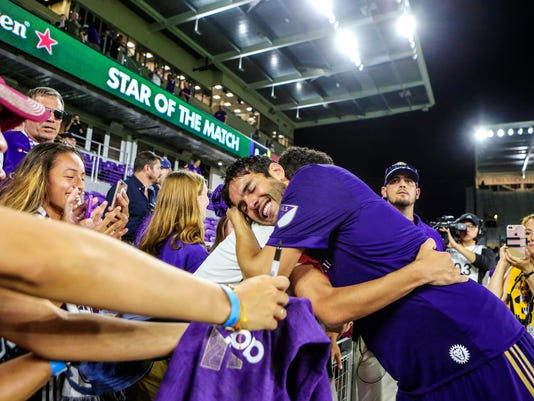 Orlando City captain Kaka hugs fans after an MLS soccer game against the Columbus Crew in Orlando, Fla., Sunday, Oct. 15, 2017. Kaka, the 35-year-old Brazilian soccer star, announced on Wednesday he would not re-sign with Orlando City after a three-year run with the expansion team. (Jacob Langston/Orlando Sentinel via AP)