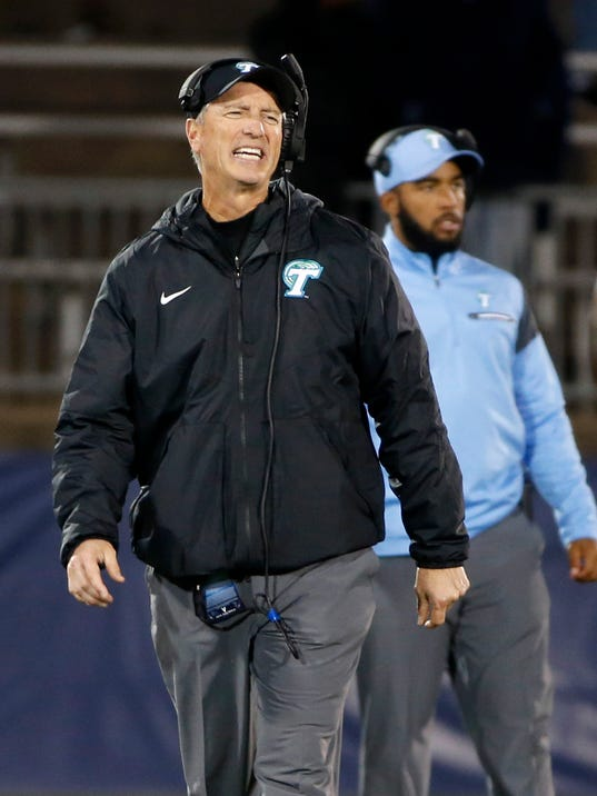 """FILE - In this Nov. 26, 2016, file photo, Tulane head coach Willie Fritz reacts to a call during the second half of an NCAA college football game against Connecticut, in East Hartford, Conn. Fritz was head coach at Georgia Southern when the Eagles took a 20-10 lead in the fourth quarter of their 2014 opener against North Carolina State. The Wolfpack rallied to win 24-23 after Fritz made a fourth-down decision _ a gut call he is still kicking himself about. Fritz is no longer interested in following his gut.""""That may be the hot dog I had before the game,"""" Fritz said. """"I want facts and numbers."""" When it comes to in-game strategy, a six-year-old company named Championship Analytics, Inc., is quickly making a mark. (AP Photo/Mary Schwalm, File)"""