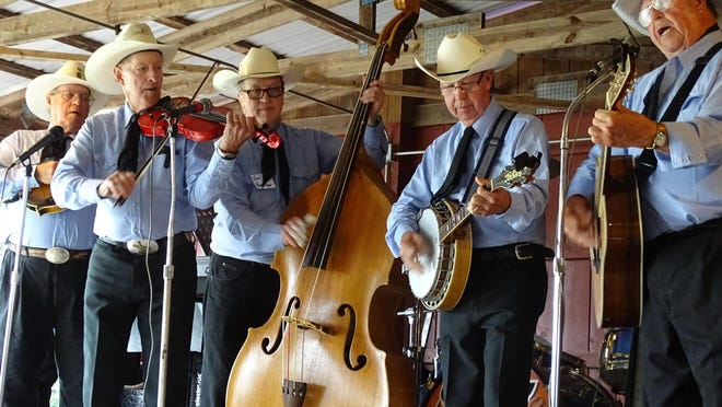 The Sleek Brothers celebrated 60 years together as a band with a concert Sunday at White Star Park in Gibsonburg. Founding band members and family took turns playing traditional country tunes, with audience members square-dancing for part of the show.