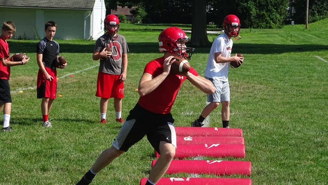 Quarterback Andrew Mason runs through a drill in the second session of two-a-days.