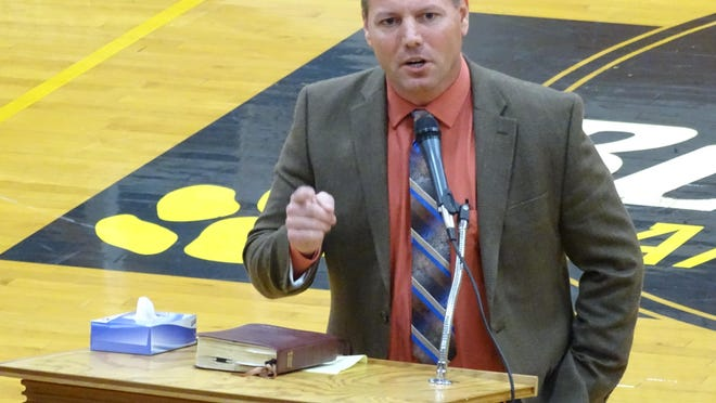 Pastor Brett Smith was one of several members of the faith community to speak at Sunday's community memorial event.