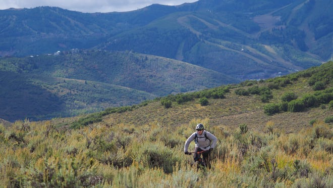 Scott House rides a mountain bike at Round Valley, near Park City, Utah, in September 2019.